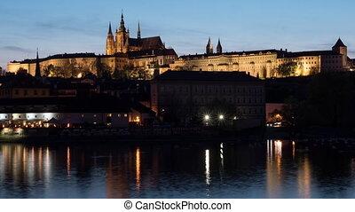 Timelapse of ships on river near Prague Castle at night