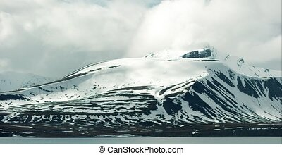 Timelapse of snowy mountains in cold arctic environment -...