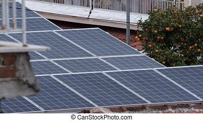 Timelapse of solar battery on house roof