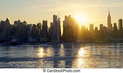 Timelapse of sunrise over Manhattan skyline