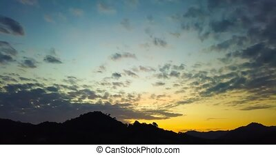 Timelapse of sunrise over mountains
