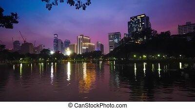 Timelapse of sunset in Lumpini park in Bangkok