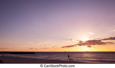 Timelapse of sunset on Cottesloe beach, Perth, Western...