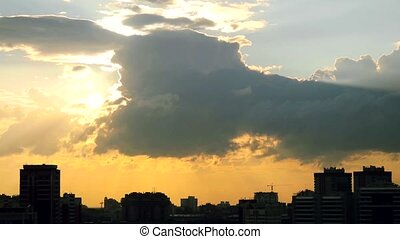 timelapse of Sunset over downtown city skyline on silhouette of architecture