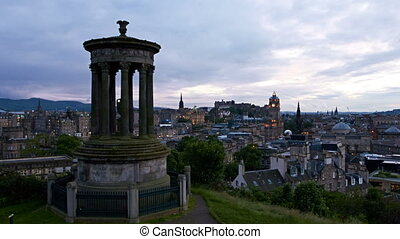 timelapse of sunset over edinburgh from calton hill,...
