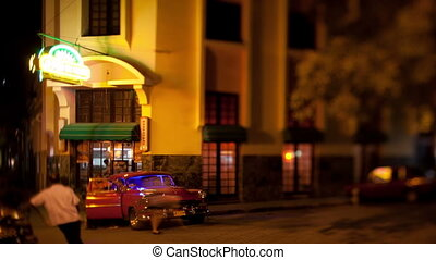 timelapse of the a bar and street scene in havana, cuba, at night