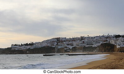 Timelapse of the beach at Albufeira, Portugal at twilight