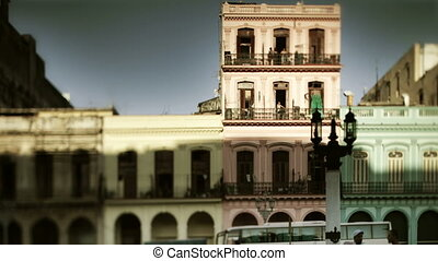 timelapse of the evening shadow running up coourful buildings at sunset, havana, cuba