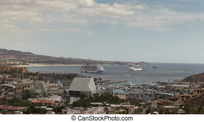 timelapse of the port and boats in cabo san lucas, mexico, shot from the hills above
