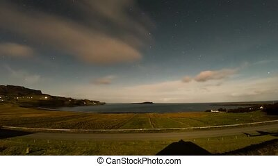 Timelapse of the sky above Staffin Bay on the Isle of Skye with stars and clouds