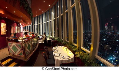 timelapse of the view from the rotating restaurant at the top of the world trade centre in mexico city, at night