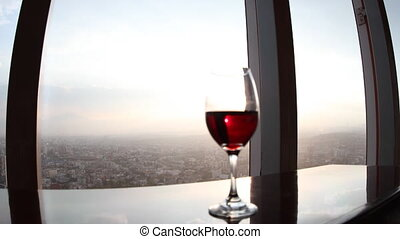 timelapse of the view from the rotating restaurant at the top of the world trade centre in mexico city, with a wine glass in the foreground