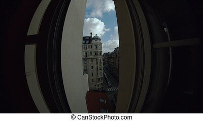 Timelapse of traffic in Parisian street, clouds sailing in the sky