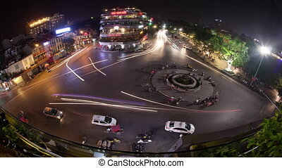 Timelapse of traffic on city square in night Hanoi, Vietnam