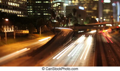 timelapse of traffic on freeway in downtown los angeles at...