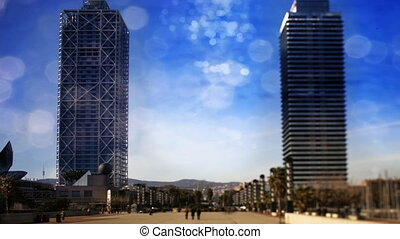 timelapse of two skyscrapers in barcelona's port olympic