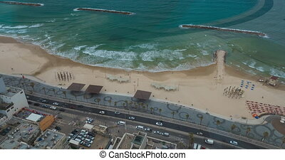Timelapse of waves, car and people traffic on sea-front. Tel Aviv, Israel