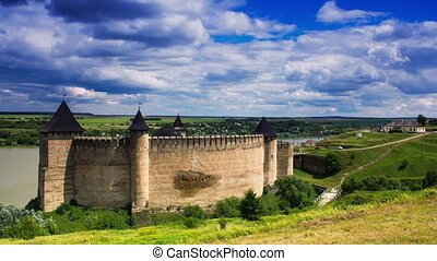 Timelapse of white clouds passing by over an old castle in Khotin, Ukraine