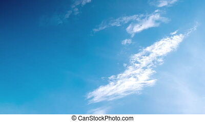 Timelapse of white clouds with blue sky in background