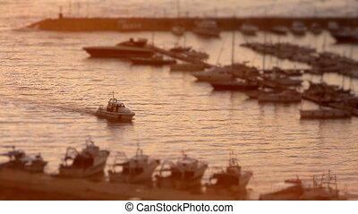 Timelapse of White Motor Boat Arriving at marina of Santa Maria di Leuca at sunset