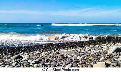 Timelapse of wild stone beach on coast or shore of the...