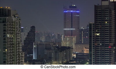 Timelapse of windows lights blinking in night Bangkok, Thailand