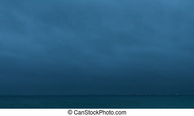 Timelapse. Rainy clouds over evening northern sea. -...