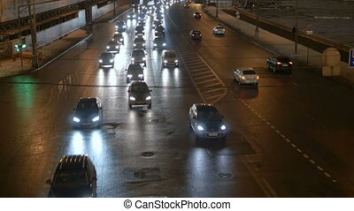 Timelapse. Rapid movement of cars on city streets. In evening time. Big wide road