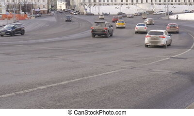 Timelapse. Rapid movement of cars on city streets. On a sunny day. Big wide road