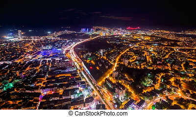 Timelapse rooftop view of Istanbul with traffic light at night
