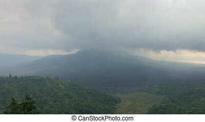 Timelapse shot of clouds moving over the Batur volcano on the Bali island. Travel to Bali concept.
