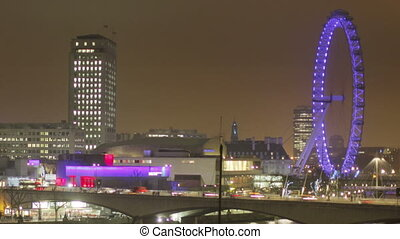timelapse shots of the london eye and river thames at night