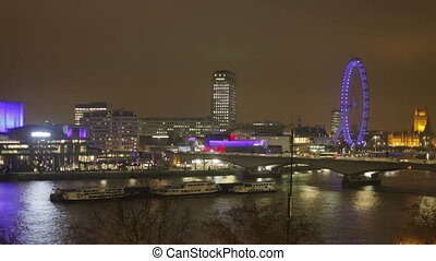 timelapse shots of the london eye and river thames at night with boat traffic