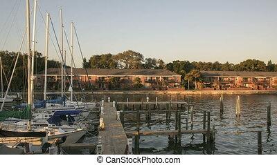 Timelapse Sundown harbor - Time lapse sundown of yachts and...
