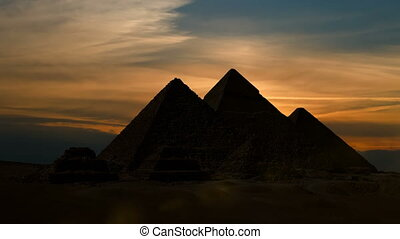 Timelapse. Sunet over the pyramid of Cheops. Giza Egypt.