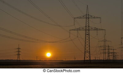 Timelapse Sunset Power Lines and Wind Turbine
