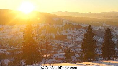 Timelapse sunset winter village mountain