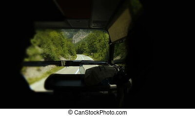 Timelapse tourists drive on the road in a bus in Montenegro...