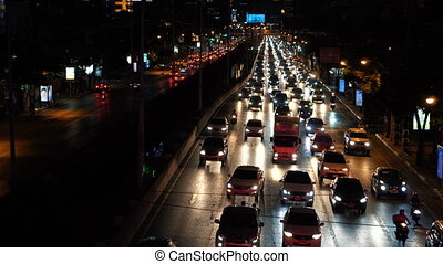 Timelapse traffic jam in downtown at dark evening time