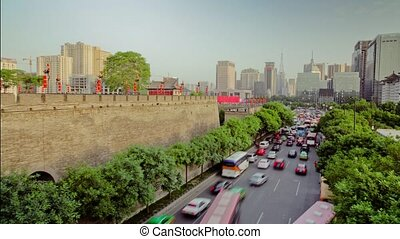 Timelapse Traffic on busy street near by xi'an city wall...