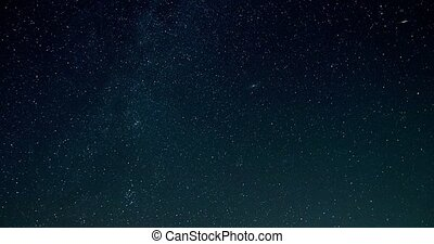 Timelapse video of night sky with falling stars turning into...