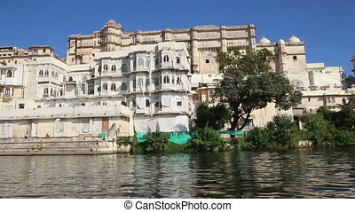 timelapse view from boat on lake and palaces in Udaipur India