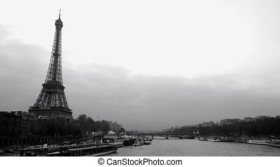 timelapse view of eifel tower and the river seine, paris,...