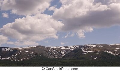 Timelapse view of fast moving clouds over the mountains