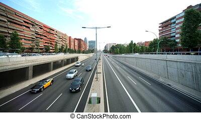 timelapse wide-angle evening traffic shot from a bridge in barcelona spain