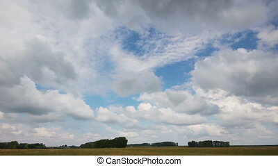 timelapse with clouds moving over field