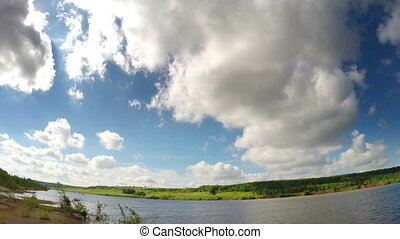 timelapse with clouds moving over river