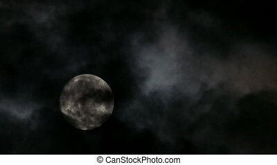 timelapse with full moon moving between clouds