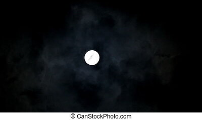 timelapse with moon between clouds