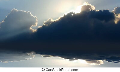timelapse with sun behind clouds over sea